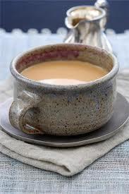 Чашка - внутри монгольский чай с молоком